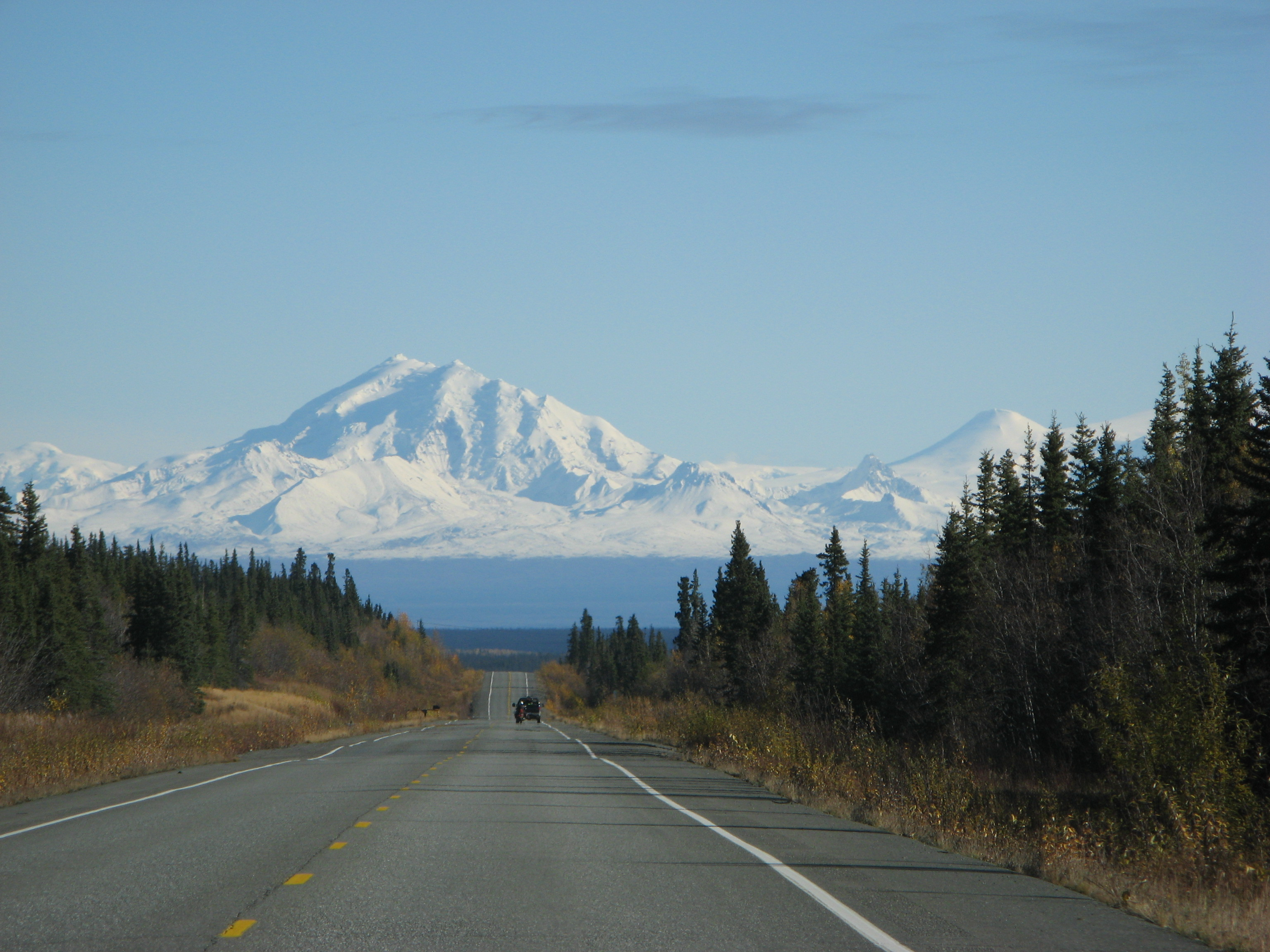 Mountain hovering over Alaska road.