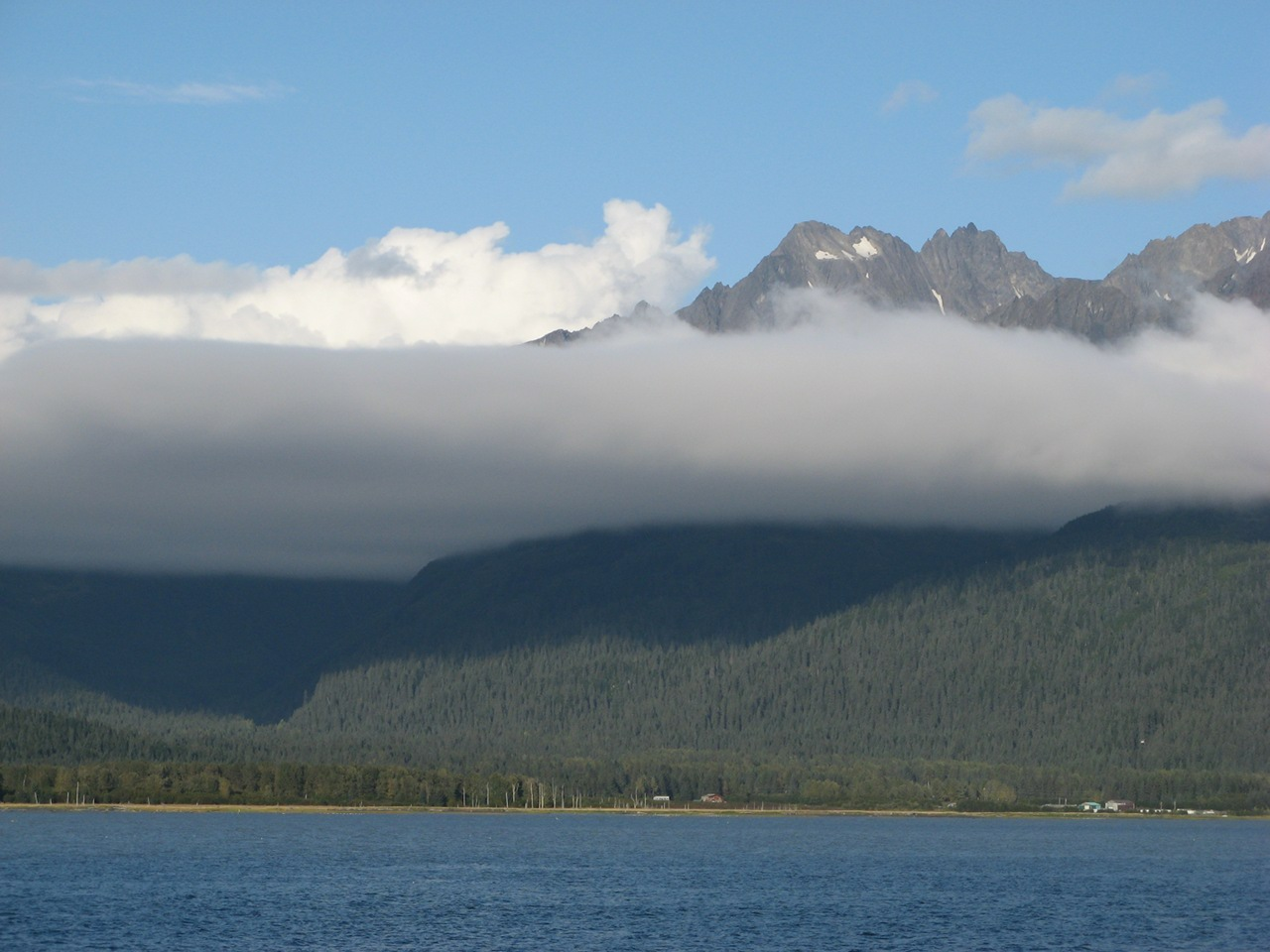 Seward, Alaska - Clouds hovering in mountain.