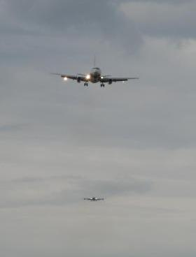 Two planes bearing in on the Ted Stevens airport