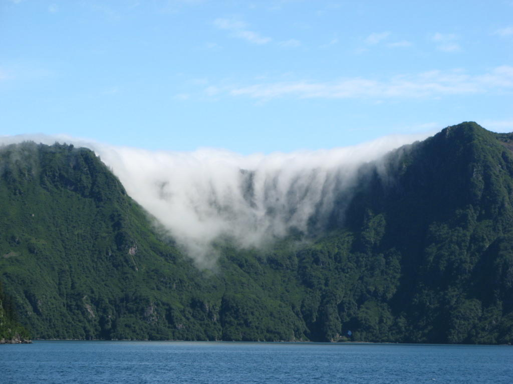 Fog rolling in over mountain