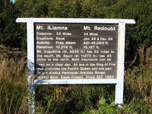 A sign on the road with info on Mt. Iliamma and Mt. Redoubt